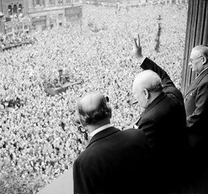 Churchill waves to crowds in Whitehall on the day he broadcast to the nation that the war with Germany had been won, 8 May 1945.